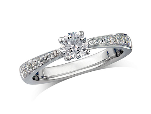 Platinum set single stone diamond engagement ring, with a certificated brilliant cut centre in a four claw setting, and diamond set shoulders. Perfect fit with a wedding ring. Total diamond weight: 0.60ct