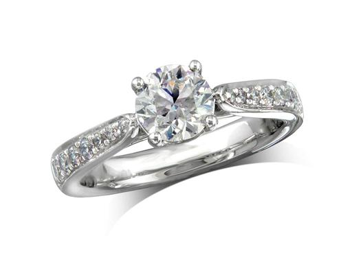 Platinum set single stone diamond engagement ring, with a certificated brilliant cut centre in a four claw setting, and diamond set shoulders. Perfect fit with a wedding ring. Total diamond weight: 1.22ct