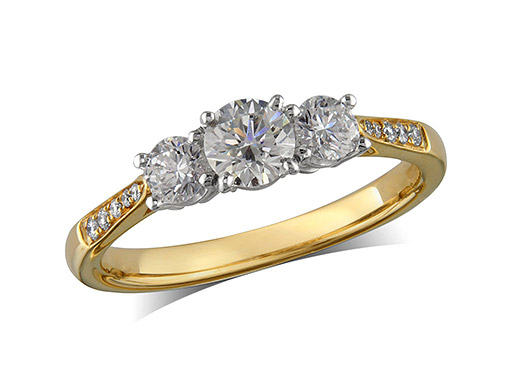 18 carat yellow gold set three stone diamond engagement ring, with a certificated brilliant cut centre in a four claw setting, and one brilliant cut with diamond set shoulders on each side. Perfect fit with a wedding ring. Total diamond weight:  0.77ct
