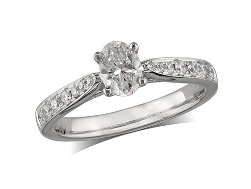 Platinum set single stone diamond engagement ring, with a certificated oval cut centre in a four claw setting, and diamond set shoulders. Perfect fit with a wedding ring. Total diamond weight: 0.77