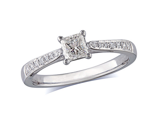Platinum set single stone diamond engagement ring, with a certificated princess cut centre in a four claw setting, and diamond set shoulders. Perfect fit with a wedding ring. Total diamond weight:0.59