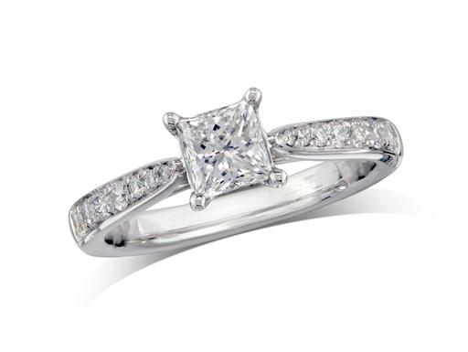 Platinum set single stone diamond ring with a certificated Princess cut centre stone in a four claw setting with diamond set shoulders. Total diamond weight: 1.04ct
