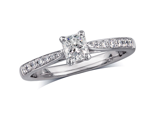 Platinum set single stone diamond engagement ring, with a certificated radliant cut centre in a four claw setting, and diamond set shoulders. Perfect fit with a wedding ring. Total diamond weight: 0.51ct