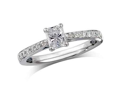 Platinum set single stone diamond engagement ring, with a certificated radliant cut centre in a four claw setting, and diamond set shoulders. Perfect fit with a wedding ring. Total diamond weight: 0.59ct