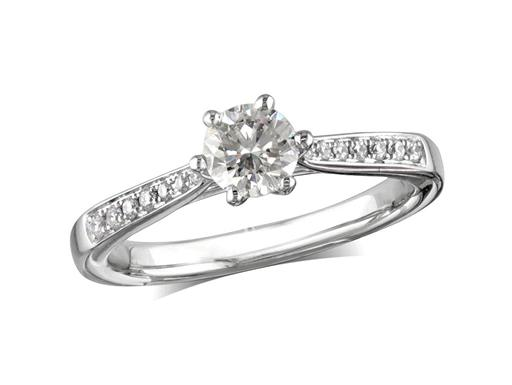 Platinum set single stone diamond engagement ring, with a certificated brilliant cut centre in a six claw setting, and diamond set shoulders. Perfect fit with a wedding ring. Total diamond weight: 0.45ct
