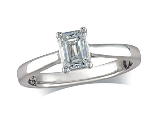 Platinum set single stone diamond ring, with a certificated Emerald cut, in a four claw setting. Perfect fit with a wedding ring.
