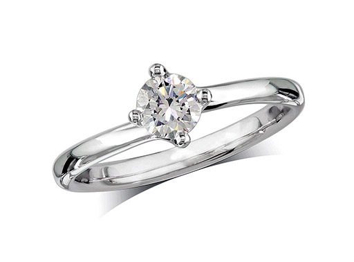 Platinum set single stone diamond engagement ring, with a certificated brilliant cut centre in a four claw setting, and diamond set shoulders. Perfect fit with a wedding ring.