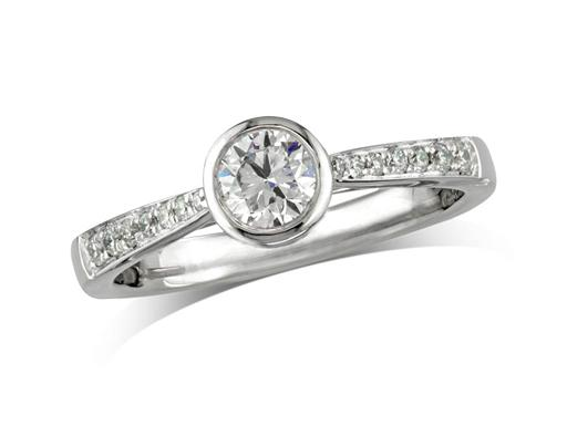 Platinum set single stone diamond engagement ring, with a certificated brilliant cut centre in a rub-over setting, and diamond set shoulders. Perfect fit with a wedding ring.