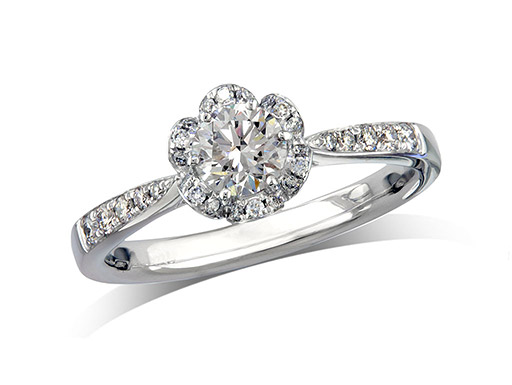 Platinum set diamond ring, with a certificated brilliant cut centre in a four claw setting, surrounded by a diamond set cluster and shoulders. Perfect fit with a wedding ring. Total diamond weight: 0.70cts
