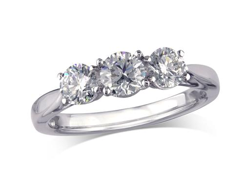 Platinum set three stone diamond engagement ring, with a certificated brilliant cut centre in a four claw setting, and one brilliant cut on each shoulder. Perfect fit with a wedding ring. Total diamond weight: 0.59ct