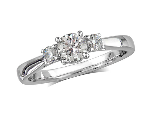 Platinum set three stone diamond engagement ring, with a certificated brilliant cut centre in a four claw setting, and one brilliant cut on each shoulder. Perfect fit with a wedding ring. Total diamond weight: 0.58ct