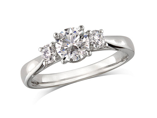 Platinum set three stone diamond engagement ring, with a certificated brilliant cut centre in a four claw setting, and one brilliant cut on each shoulder. Perfect fit with a wedding ring. Total diamond weight: 0.96ct.