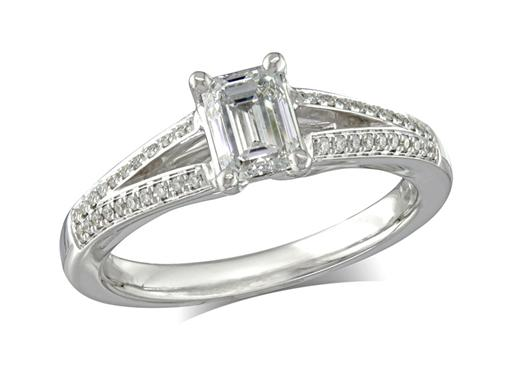 Platinum set single stone diamond engagement ring, with a certificated emerald cut centre in a four claw setting, and diamond set shoulders. Perfect fit with a wedding ring. Total diamond weight: 0.85ct.