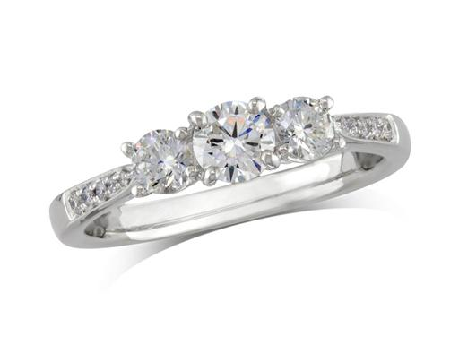 Platinum set three stone diamond engagement ring, with a certificated brilliant cut centre in a four claw setting, and one brilliant cut with diamond set shoulders on each side. Perfect fit with a wedding ring. Total diamond weight:0.69