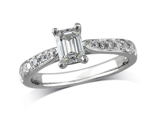 Platinum set single stone diamond engagement ring, with a certificated emerald cut centre in a four claw setting, and diamond set shoulders. Perfect fit with a wedding ring. Total diamond weight: 1.10cts