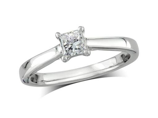 Platinum set single stone diamond engagement ring, with a certificated princess cut, in a four claw setting. Perfect fit with a wedding ring.
