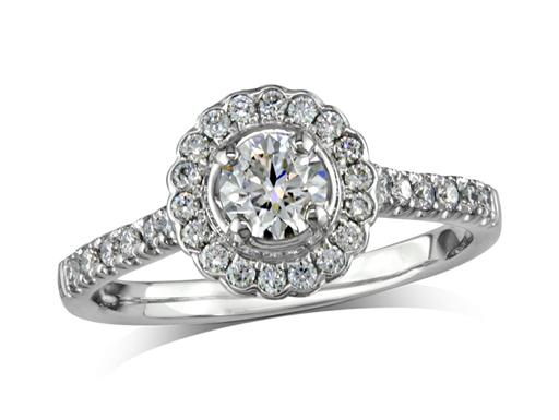Platinum set diamond cluster engagement ring, with a certified brilliant cut centre in a four claw setting, with a surrounding diamond set bezel and diamond set shoulders. Perfect fit with a wedding ring. Total cluster diamond weight: 0.73ct.