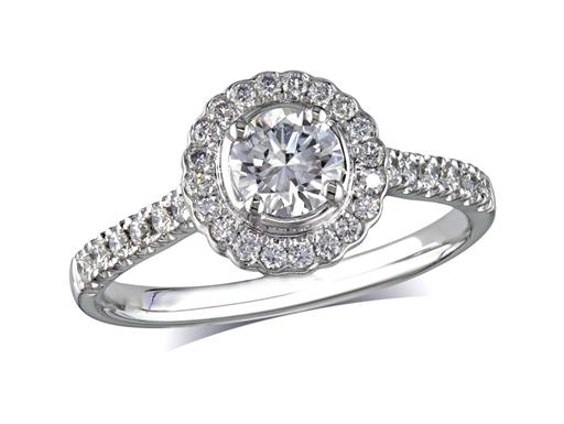 Platinum set diamond cluster engagement ring, with a certified brilliant cut centre in a four claw setting, with a surrounding diamond set bezel and diamond set shoulders. Perfect fit with a wedding ring. Total cluster diamond weight:0.79