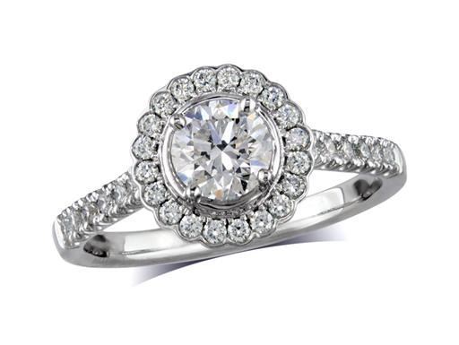 Platinum set diamond cluster engagement ring, with a certified brilliant cut centre in a four claw setting, with a surrounding diamond set bezel and diamond set shoulders. Perfect fit with a wedding ring. Total cluster diamond weight: 0.92ct.