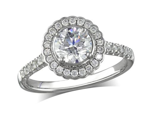 Platinum set diamond cluster engagement ring, with a certified brilliant cut centre in a four claw setting, with a surrounding diamond set bezel and diamond set shoulders. Perfect fit with a wedding ring. Total cluster diamond weight: 1.25ct.