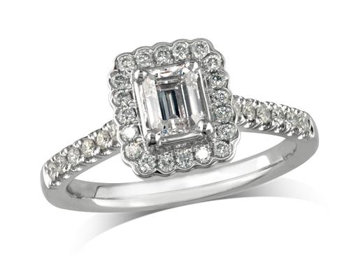 Platinum set diamond cluster engagement ring, with a certified emerald cut centre in a four claw setting, with a surrounding diamond set bezel and diamond set shoulders. Perfect fit with a wedding ring. Total cluster diamond weight: 0.73ct.