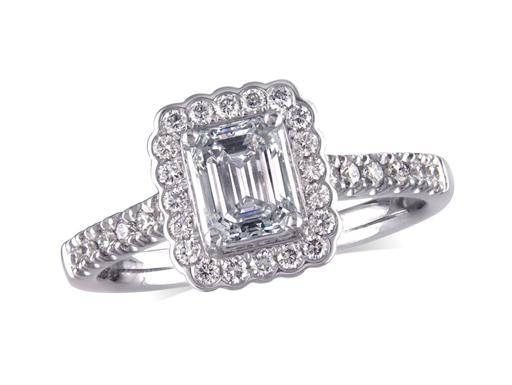 Platinum set diamond cluster engagement ring, with a certified emerald cut centre in a four claw setting, with a surrounding diamond set bezel and diamond set shoulders. Perfect fit with a wedding ring. Total cluster diamond weight: 1.14ct.