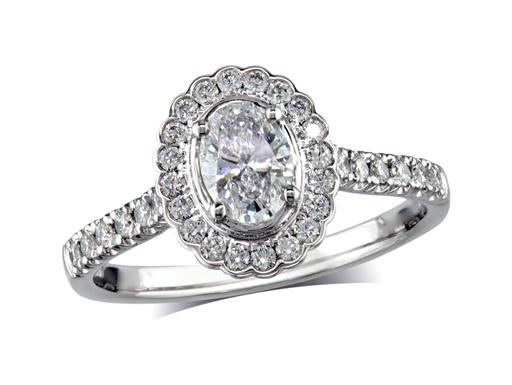 Platinum set diamond cluster engagement ring, with a certified oval cut centre in a four claw setting, with a surrounding diamond set bezel and diamond set shoulders. Perfect fit with a wedding ring. Total cluster diamond weight: 0.89ct.