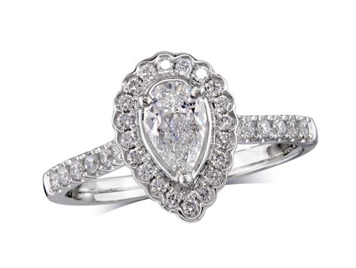 Platinum set diamond cluster engagement ring, with a certified pear cut centre in a three claw setting, with a surrounding diamond set bezel and diamond set shoulders. Perfect fit with a wedding ring. Total cluster diamond weight: 0.80ct.