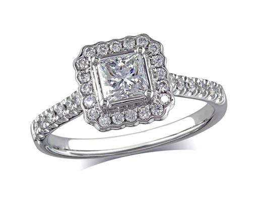 Platinum set diamond cluster engagement ring, with a certificated princess cut centre in a four claw setting, with a surrounding diamond set bezel and diamond set shoulders. Perfect fit with a wedding ring. Total cluster diamond weight: 0.88ct.
