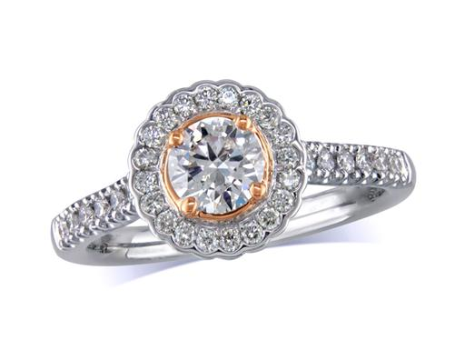 Platinum set diamond cluster engagement ring, with a certified brilliant cut centre in a four claw rose gold setting, with a surrounding diamond set bezel and diamond set shoulders. Perfect fit with a wedding ring. Total cluster diamond weight: 0.75cts