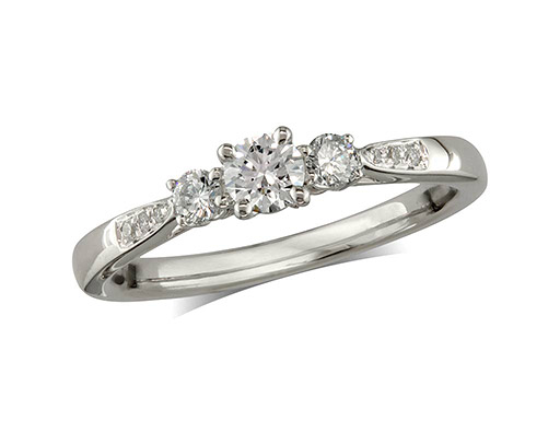 Platinum set three stone diamond engagement ring, with a certificated brilliant cut centre in a four claw setting, and one brilliant cut with diamond set shoulders on each side. Perfect fit with a wedding ring. Total diamond weight: 0.35cts