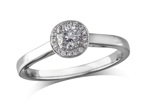 Platinum set diamond ring, with a certificated brilliant cut centre in a four claw setting, surrounded by a diamond set cluster. Perfect fit with a wedding ring. Total diamond weight: 0.25ct.