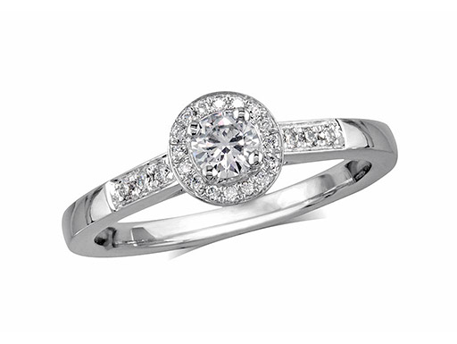 Platinum set diamond cluster engagement ring, with a certificated brilliant cut centre in a four claw setting, with a surrounding diamond set bezel and diamond set shoulders. Perfect fit with a wedding ring. Total cluster diamond weight: 0.31ct