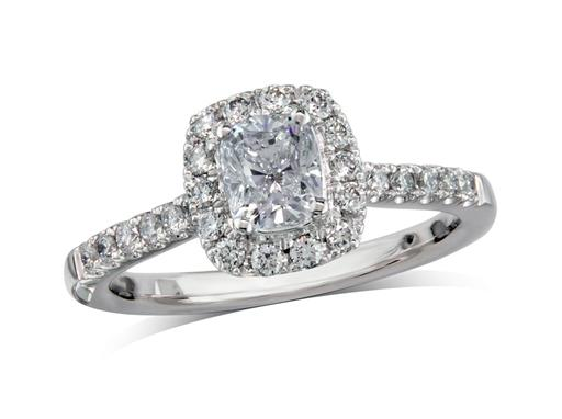 Platinum set diamond cluster engagement ring, with a certificated cushion cut centre in a four claw setting, with a surrounding diamond set bezel and diamond set shoulders. Perfect fit with a wedding ring. Total cluster diamond weight: 0.87ct.