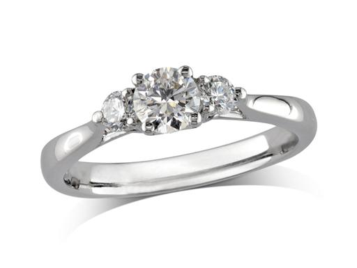 Platinum set three stone diamond engagement ring, with a certificated brilliant cut centre in a four claw setting, and one brilliant cut on each shoulder. Perfect fit with a wedding ring. Total diamond weight: 0.60cts
