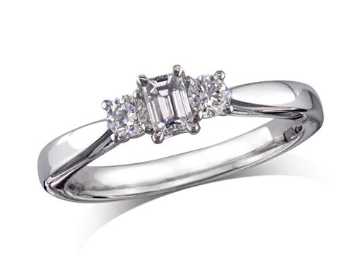 Platinum set three stone diamond engagement ring, with a certificated emerald cut centre in a four claw setting, and one brilliant cut on each shoulder. Perfect fit with a wedding ring. Total diamond weight: 0.41ct