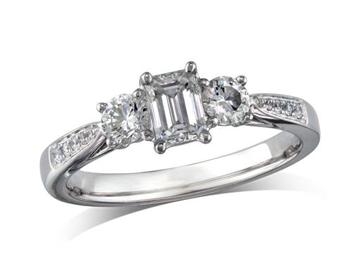 Platinum set three stone diamond engagement ring, with a certificated emerald cut centre in a four claw setting, and one brilliant cut on each side with diamond set shoulders. Perfect fit with a wedding ring. Total diamond weight:0.66