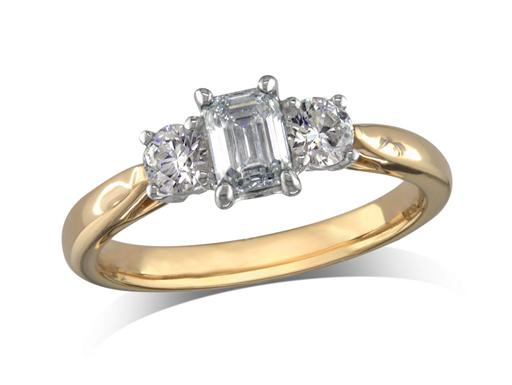 18 carat yellow gold set three stone diamond engagement ring, with a certificated emerald cut centre in a four claw setting, and one brilliant cut on each shoulder. Perfect fit with a wedding ring. Total diamond weight: 0.82ct.