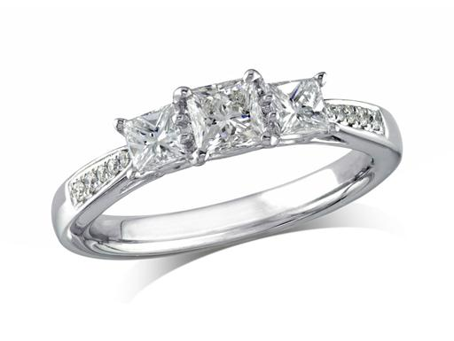 Platinum set three stone diamond engagement ring, with a certificated princess cut centre in a four claw setting, and one princess cut on each side with diamond set shoulders. Perfect fit with a wedding ring. Total diamond weight:0.87