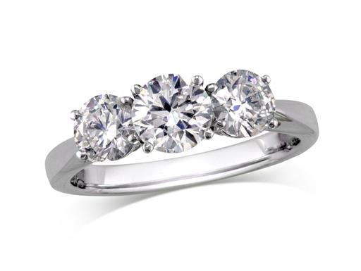 Platinum set three stone diamond engagement ring, with a certificated brilliant cut centre in a four claw setting, and one brilliant cut on each shoulder. Perfect fit with a wedding ring. Total diamond weight: 1.38ct.