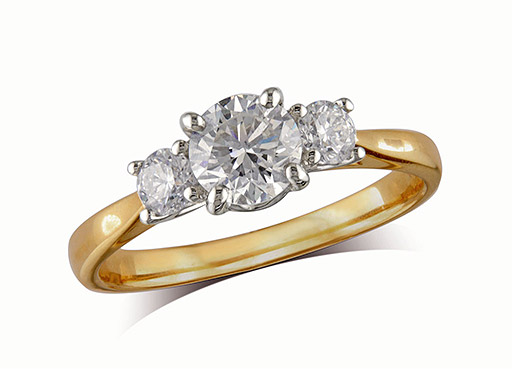18 carat yellow gold set three stone diamond engagement ring, with a certificated brilliant cut centre in a four claw setting, and one brilliant cut on each shoulder. Perfect fit with a wedding ring. Total diamond weight: 0.96ct.