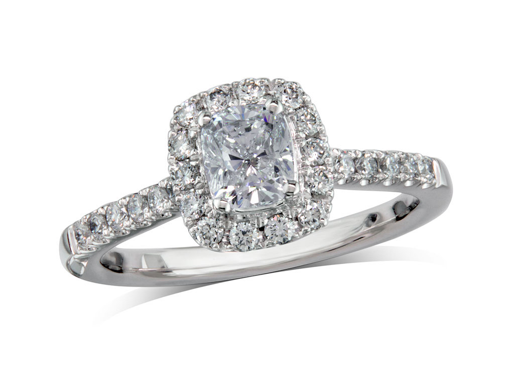 Platinum set diamond cluster engagement ring, with a certificated cushion cut centre in a four claw setting, with a surrounding diamond set bezel and diamond set shoulders. Perfect fit with a wedding ring. Total cluster diamond weight: 0.85ct.