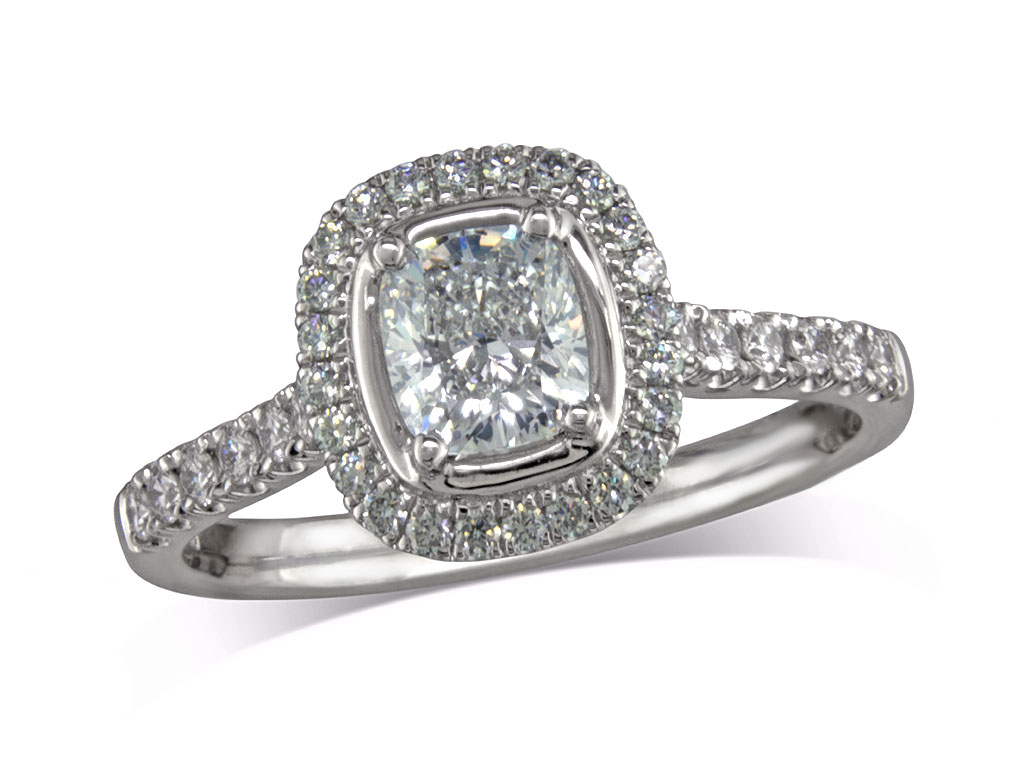 Platinum set diamond cluster engagement ring, with a certificated cushion cut centre in a four claw setting, with a surrounding diamond set bezel and diamond set shoulders. Perfect fit with a wedding ring. Total cluster diamond weight: 1.30ct.