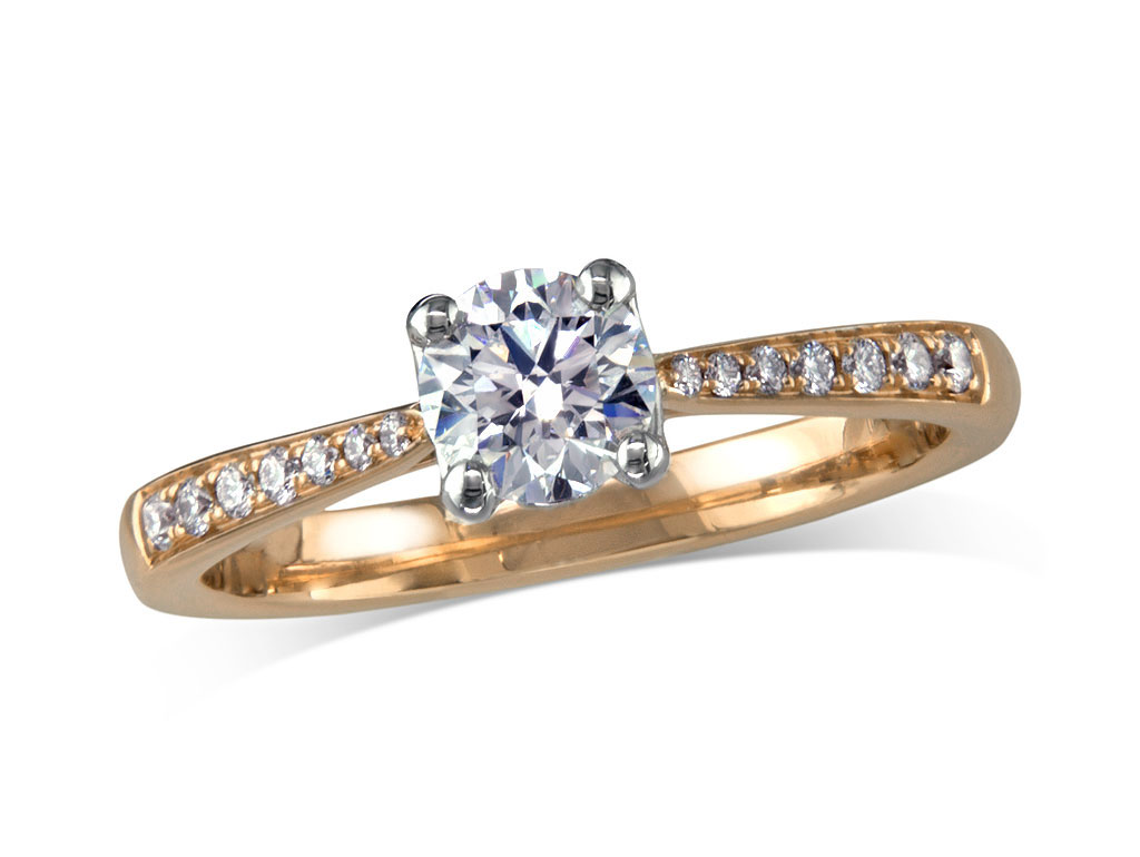 18 carat yellow gold set single stone diamond engagement ring, with a certificated brilliant cut centre in a four claw setting, and diamond set shoulders. Perfect fit with a wedding ring. Total diamond weight: 0.53ct.