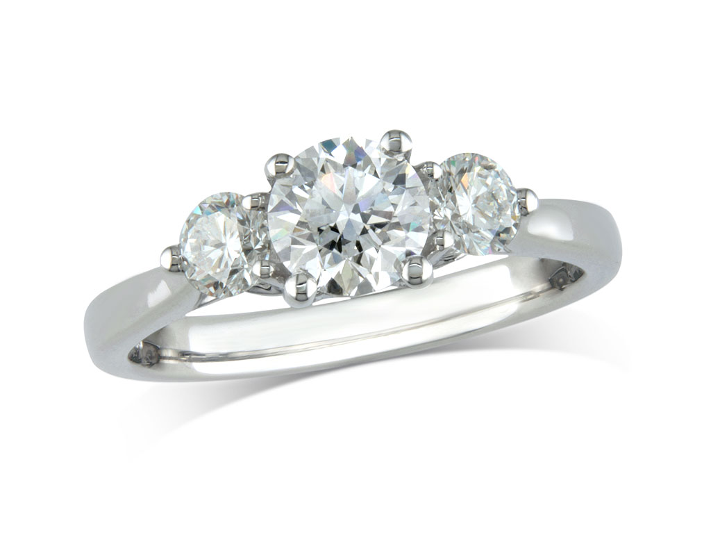 Platinum set three stone diamond engagement ring, with a certificated brilliant cut centre in a four claw setting, and one brilliant cut on each shoulder. Perfect fit with a wedding ring. Total diamond weight: 1.13ct.