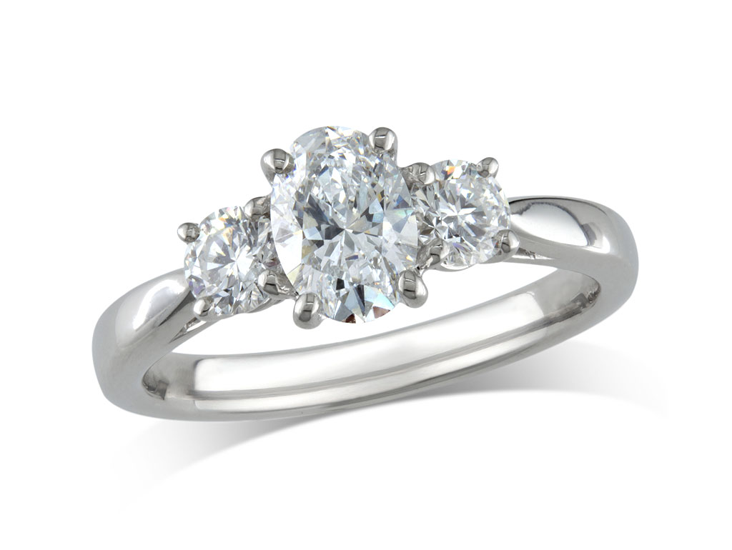 A 0.70ct, Oval, F, Three stone diamond ring. You can buy online or reserve online and view in store at Michael Jones Jeweller, Banbury