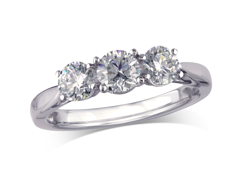 Platinum set three stone diamond engagement ring, with a certificated brilliant cut centre in a four claw setting, and one brilliant cut on each shoulder. Perfect fit with a wedding ring. Total diamond weight: 0.78ct.