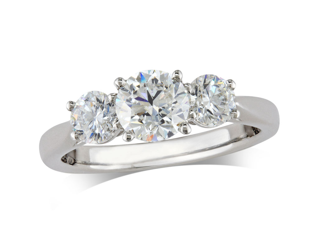 Platinum set three stone diamond engagement ring, with a certificated brilliant cut centre in a four claw setting, and one brilliant cut on each shoulder. Perfect fit with a wedding ring. Total diamond weight: 1.92ct.