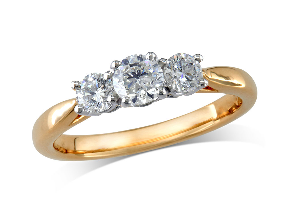 18 carat yellow gold set three stone diamond engagement ring, with a certificated brilliant cut centre in a four claw setting, and one brilliant cut on each shoulder. Perfect fit with a wedding ring. Total diamond weight: 0.95ct.