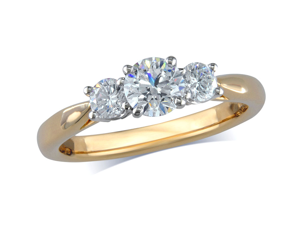 18 carat yellow gold set three stone diamond engagement ring, with a certificated brilliant cut centre in a four claw setting, and one brilliant cut on each shoulder. Perfect fit with a wedding ring. Total diamond weight: 1.10ct.